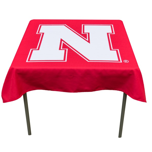 Nebraska Cornhuskers Table Cloth measures 48 x 48 inches, is made of 100% Polyester, seamless one-piece construction, and is perfect for any tailgating table, card table, or wedding table overlay. Each includes Officially Licensed Logos and Insignias.