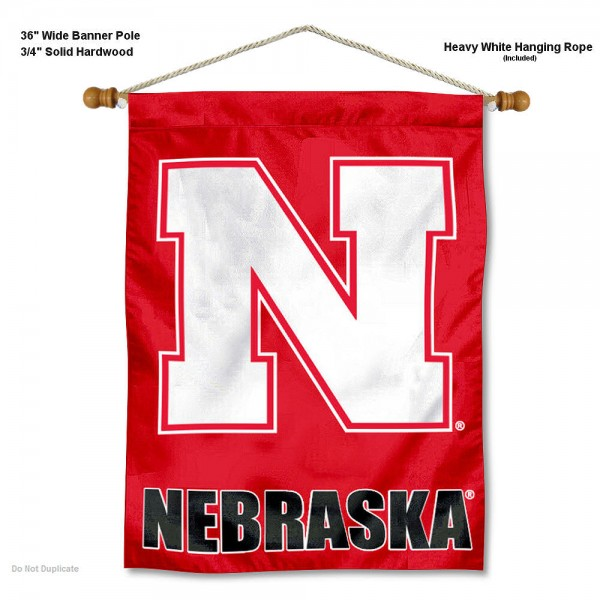 """Nebraska Cornhuskers Wall Banner is constructed of polyester material, measures a large 30""""x40"""", offers screen printed athletic logos, and includes a sturdy 3/4"""" diameter and 36"""" wide banner pole and hanging cord. Our Nebraska Cornhuskers Wall Banner is Officially Licensed by the selected college and NCAA."""