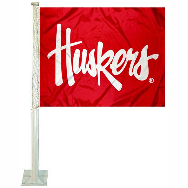 Nebraska Huskers Script Huskers Car Flag measures 12x15 inches, is constructed of sturdy 2 ply polyester, and has screen printed school logos which are readable and viewable correctly on both sides. Nebraska Huskers Script Huskers Car Flag is officially licensed by the NCAA and selected university.