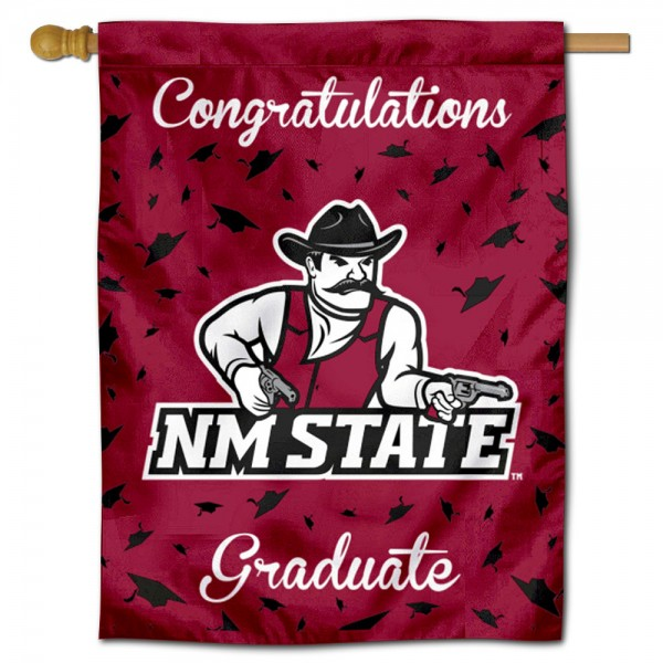 New Mexico State Aggies Congratulations Graduate Flag measures 30x40 inches, is made of poly, has a top hanging sleeve, and offers dye sublimated New Mexico State Aggies logos. This Decorative New Mexico State Aggies Congratulations Graduate House Flag is officially licensed by the NCAA.