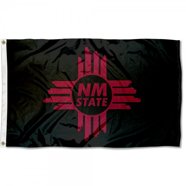 New Mexico State Aggies State of NM Flag measures 3x5 feet, is made of 100% polyester, offers quadruple stitched flyends, has two metal grommets, and offers screen printed NCAA team logos and insignias. Our New Mexico State Aggies State of NM Flag is officially licensed by the selected university and NCAA.