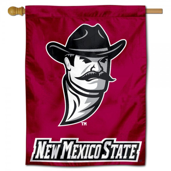 "NM State Aggies Decorative Flag is constructed of polyester material, is a vertical house flag, measures 30""x40"", offers screen printed athletic insignias, and has a top pole sleeve to hang vertically. Our NM State Aggies Decorative Flag is Officially Licensed by New Mexico State University and NCAA."