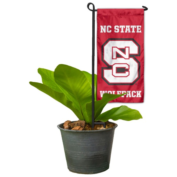"North Carolina State Wolfpack Flower Pot Topper Flag kit includes our 4""x8"" mini garden banner and 6"" x 14"" mini garden banner stand. The mini flag is made of 1-ply polyester, has screen printed logos and the garden stand is made of steel and powder coated black. This kit is NCAA Officially Licensed by the selected college or university."