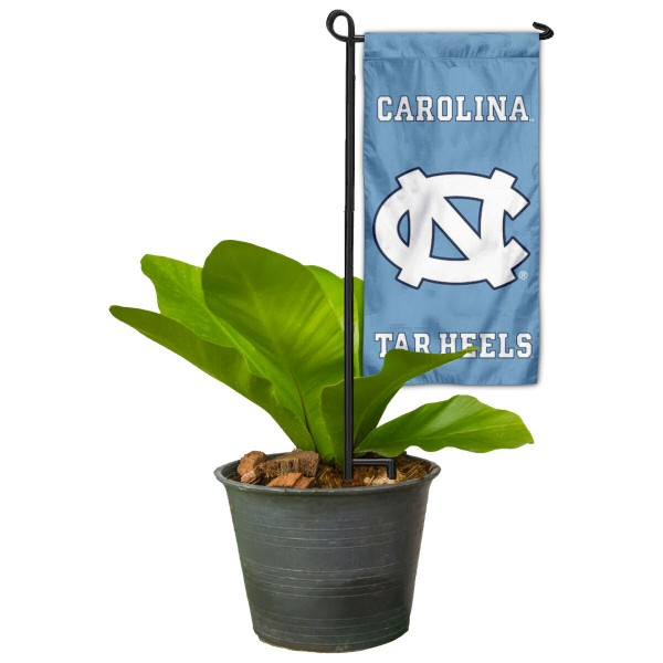 "North Carolina Tar Heels Flower Pot Topper Flag kit includes our 4""x8"" mini garden banner and 6"" x 14"" mini garden banner stand. The mini flag is made of 1-ply polyester, has screen printed logos and the garden stand is made of steel and powder coated black. This kit is NCAA Officially Licensed by the selected college or university."