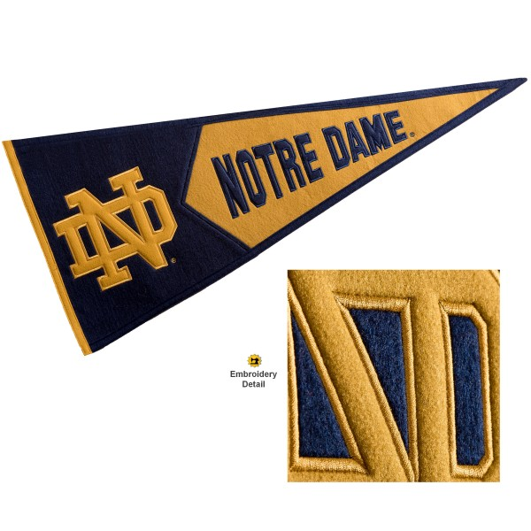 Notre Dame Fighting Irish Genuine Wool Pennant consists of our full size 13x32 inch Winning Streak Sports wool college pennant. The logos, lettering and insignia is quality embroidered and appliqued, feature a alternate logo color header, and has sewn wool perimeter. This Notre Dame Fighting Irish College Pennant Pennant is Officially Licensed and University Approved with Overnight Next Day Shipping.