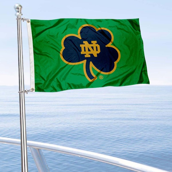 Notre Dame Shamrock Boat Flag is 12x18 inches, nylon, offers quadruple stitched flyends for durability, has two metal grommets, and is double sided. Our mini flags for Notre Dame are licensed by the university and NCAA and can be used as a boat flag, motorcycle flag, golf cart flag, or ATV flag.