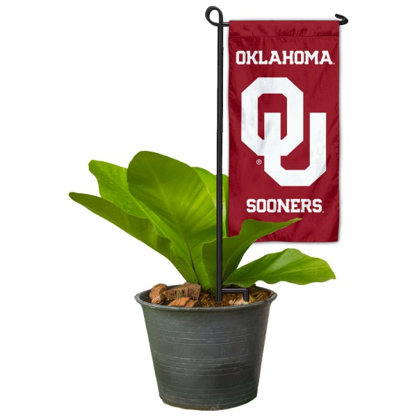 """Oklahoma Sooners Flower Pot Topper Flag kit includes our 4""""x8"""" mini garden banner and 6"""" x 14"""" mini garden banner stand. The mini flag is made of 1-ply polyester, has screen printed logos and the garden stand is made of steel and powder coated black. This kit is NCAA Officially Licensed by the selected college or university."""
