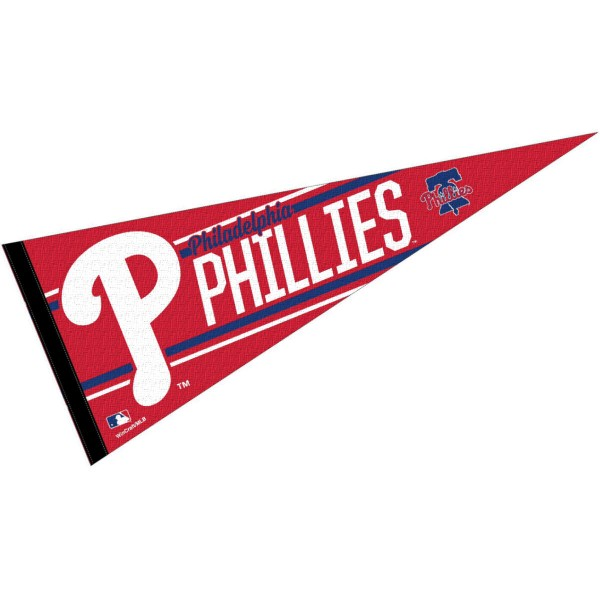 This Philadelphia Phillies Pennant measures 12x30 inches, is constructed of felt, and is single sided screen printed with the Philadelphia Phillies logo and insignia. Each Philadelphia Phillies Pennant is a MLB Genuine Merchandise product.
