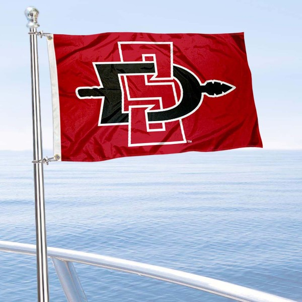 San Diego State Aztecs Boat and Mini Flag is 12x18 inches, polyester, offers quadruple stitched flyends for durability, has two metal grommets, and is double sided. Our mini flags for San Diego State Aztecs are licensed by the university and NCAA and can be used as a boat flag, motorcycle flag, golf cart flag, or ATV flag.