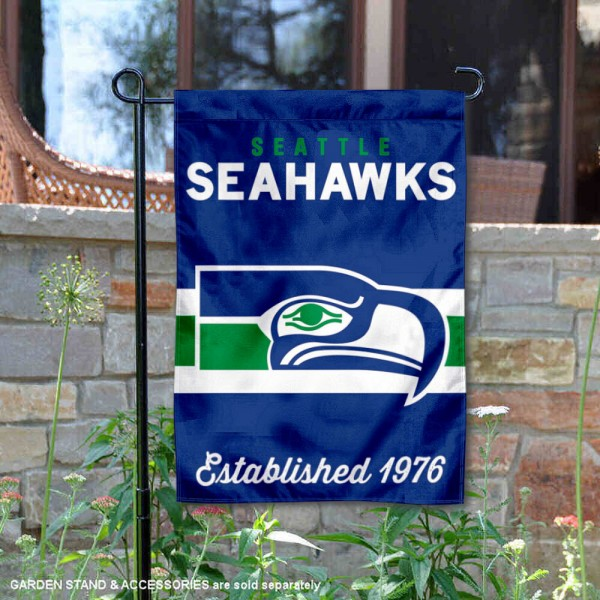 Seattle Seahawks Throwback Logo Double Sided Garden Flag Flag is 12.5x18 inches in size, is made of 2-ply polyester, and has two sided screen printed logos and lettering. Available with Express Next Day Ship, our Seattle Seahawks Throwback Logo Double Sided Garden Flag Flag is NFL Officially Licensed and is double sided.