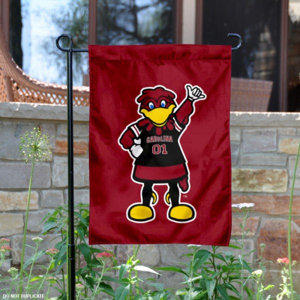 South Carolina Cocky Mascot Garden Flag is 13x18 inches in size, is made of 2-layer polyester, screen printed University of South Carolina athletic logos and lettering. Available with Same Day Express Shipping, Our South Carolina Cocky Mascot Garden Flag is officially licensed and approved by University of South Carolina and the NCAA.