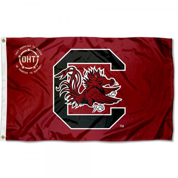South Carolina Gamecocks Operation Hat Trick Flag measures 3x5 feet, is made of 100% polyester, offers quadruple stitched flyends, has two metal grommets, and offers screen printed NCAA team logos and insignias. Our South Carolina Gamecocks Operation Hat Trick Flag is officially licensed by the selected university and NCAA.