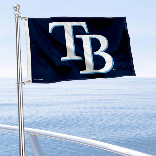 """Our Tampa Bay Rays Boat and Nautical Flag is 12""""x18"""", made of three-ply poly, has a solid header with two metal grommets, and is double sided. This Boat and Nautical Flag for Tampa Bay Rays is Officially Licensed by the MLB and can also be used as a motorcycle flag, boat flag, golf cart flag, or recreational flag."""