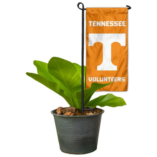 "Tennessee Volunteers Flower Pot Topper Flag kit includes our 4""x8"" mini garden banner and 6"" x 14"" mini garden banner stand. The mini flag is made of 1-ply polyester, has screen printed logos and the garden stand is made of steel and powder coated black. This kit is NCAA Officially Licensed by the selected college or university."