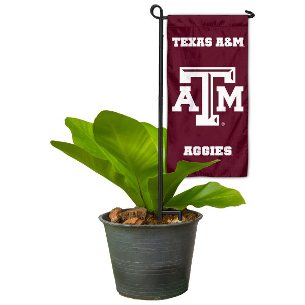 "Texas A&M Aggies Flower Pot Topper Flag kit includes our 4""x8"" mini garden banner and 6"" x 14"" mini garden banner stand. The mini flag is made of 1-ply polyester, has screen printed logos and the garden stand is made of steel and powder coated black. This kit is NCAA Officially Licensed by the selected college or university."