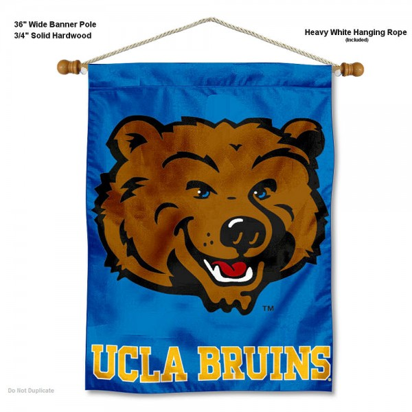 """UCLA Wall Banner is constructed of polyester material, measures a large 28""""x40"""", offers screen printed athletic logos, and includes a sturdy 3/4"""" diameter and 36"""" wide banner pole and hanging cord. Our UCLA Wall Banner is Officially Licensed by the selected college and NCAA."""
