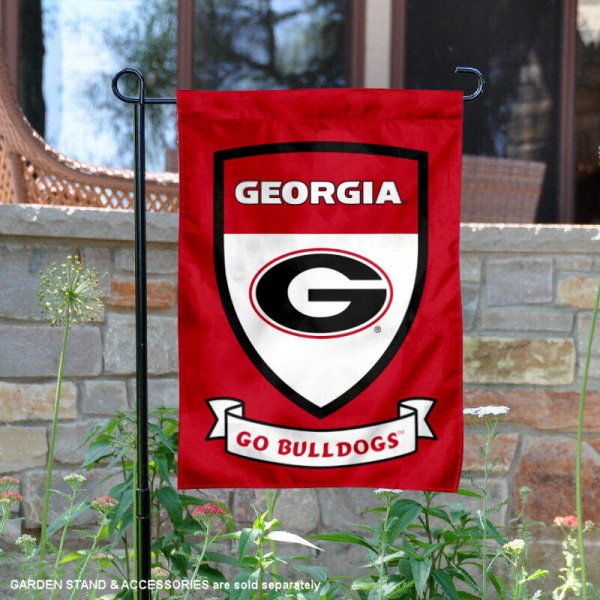 UGA Bulldogs Go Bulldogs Shield Garden Flag is 13x18 inches in size, is made of thick blockout polyester, screen printed university athletic logos and lettering, and is readable and viewable correctly on both sides. Available same day shipping, our UGA Bulldogs Go Bulldogs Shield Garden Flag is officially licensed and approved by the university and the NCAA.