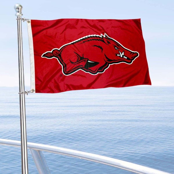 University of Arkanas Boat and Mini Flag is 12x18 inches, polyester, offers quadruple stitched flyends for durability, has two metal grommets, and is double sided. Our mini flags for University of Arkansas are licensed by the university and NCAA and can be used as a boat flag, motorcycle flag, golf cart flag, or ATV flag.