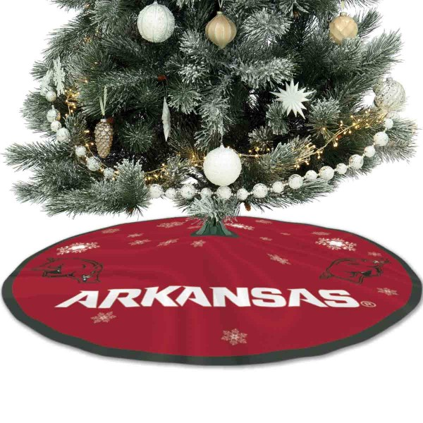 University of Arkansas Razorbacks Christmas Tree Skirt measures 56 inches circle, is made of 150d polyester, has a contrasting color border. Each college xmas tree skirt includes Officially Licensed Logos and Insignias.