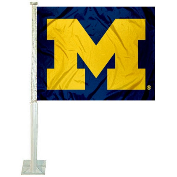 University of Michigan Car Window Flag measures 12x15 inches, is constructed of sturdy 2 ply polyester, and has screen printed school logos which are readable and viewable correctly on both sides. University of Michigan Car Window Flag is officially licensed by the NCAA and selected university.