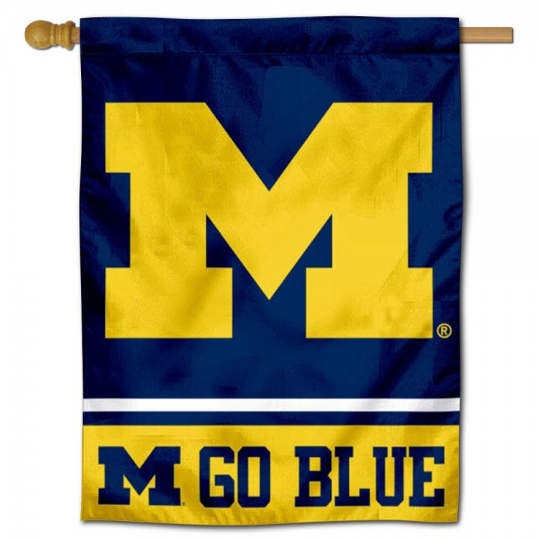 """University of Michigan Go Blue Banner Flag is constructed of polyester material, is a vertical house flag, measures 30""""x40"""", offers screen printed athletic insignias, and has a top pole sleeve to hang vertically. Our University of Michigan Go Blue Banner Flag is Officially Licensed by University of Michigan and NCAA."""