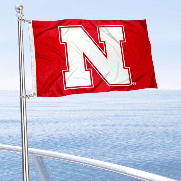 University of Nebraska Boat and Mini Flag is 12x18 inches, polyester, offers quadruple stitched flyends for durability, has two metal grommets, and is double sided. Our mini flags for University of Nebraska are licensed by the university and NCAA and can be used as a boat flag, motorcycle flag, golf cart flag, or ATV flag.