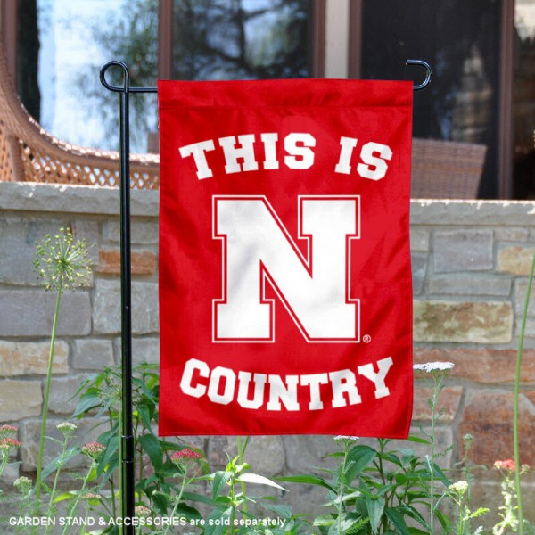 University of Nebraska Country Garden Flag is 13x18 inches in size, is made of 2-layer polyester, screen printed university athletic logos and lettering, and is readable and viewable correctly on both sides. Available same day shipping, our University of Nebraska Country Garden Flag is officially licensed and approved by the university and the NCAA.