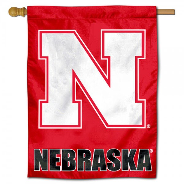 """University of Nebraska Decorative Flag is constructed of polyester material, is a vertical house flag, measures 30""""x40"""", offers screen printed athletic insignias, and has a top pole sleeve to hang vertically. Our University of Nebraska Decorative Flag is Officially Licensed by University of Nebraska and NCAA."""