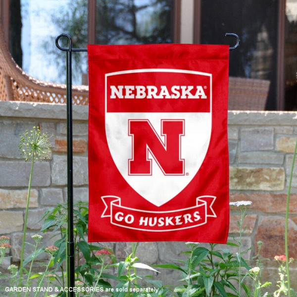 University of Nebraska Go Huskers Shield Garden Flag is 13x18 inches in size, is made of 2-layer polyester, screen printed university athletic logos and lettering, and is readable and viewable correctly on both sides. Available same day shipping, our University of Nebraska Go Huskers Shield Garden Flag is officially licensed and approved by the university and the NCAA.