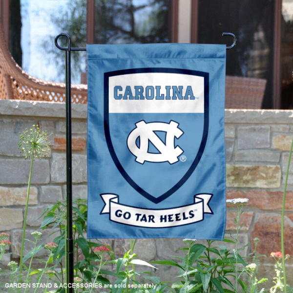 University of North Carolina Go Tar Heels Shield Garden Flag is 13x18 inches in size, is made of 2-layer polyester, screen printed university athletic logos and lettering, and is readable and viewable correctly on both sides. Available same day shipping, our University of North Carolina Go Tar Heels Shield Garden Flag is officially licensed and approved by the university and the NCAA.