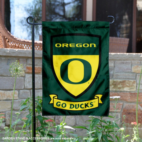 University of Oregon Go Ducks Shield Garden Flag is 13x18 inches in size, is made of 2-layer polyester, screen printed university athletic logos and lettering, and is readable and viewable correctly on both sides. Available same day shipping, our University of Oregon Go Ducks Shield Garden Flag is officially licensed and approved by the university and the NCAA.