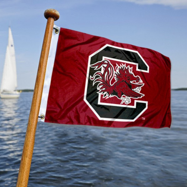 University of South Carolina Nautical Flag measures 12x18 inches, is made of two-ply polyesters, offers quadruple stitched flyends for durability, has two metal grommets, and is viewable from both sides. Our University of South Carolina Nautical Flag is officially licensed by the selected university and the NCAA and can be used as a motorcycle flag, golf cart flag, or ATV flag