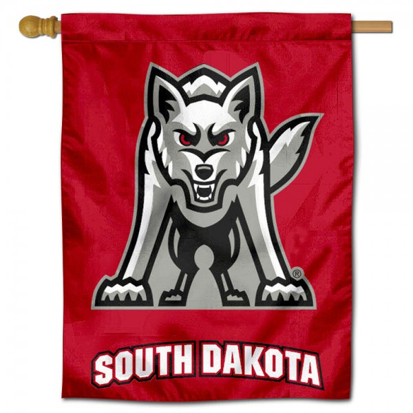 """University of South Dakota House Flag is constructed of polyester material, is a vertical house flag, measures 30""""x40"""", offers screen printed athletic insignias, and has a top pole sleeve to hang vertically. Our University of South Dakota House Flag is Officially Licensed by South Dakota Coyotes and NCAA."""