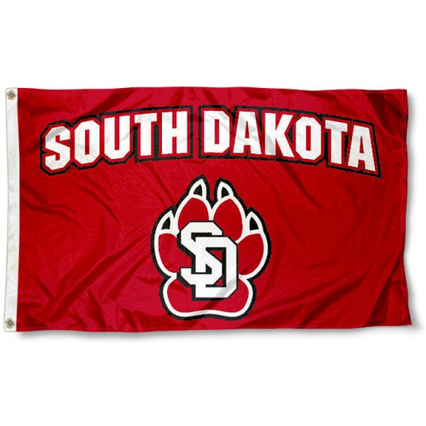 University of South Dakota Red Flag measures 3'x5', is made of 100% poly, has quadruple stitched sewing, two metal grommets, and has double sided Team University logos. Our Coyotes 3x5 Flag is officially licensed by the selected university and the NCAA.