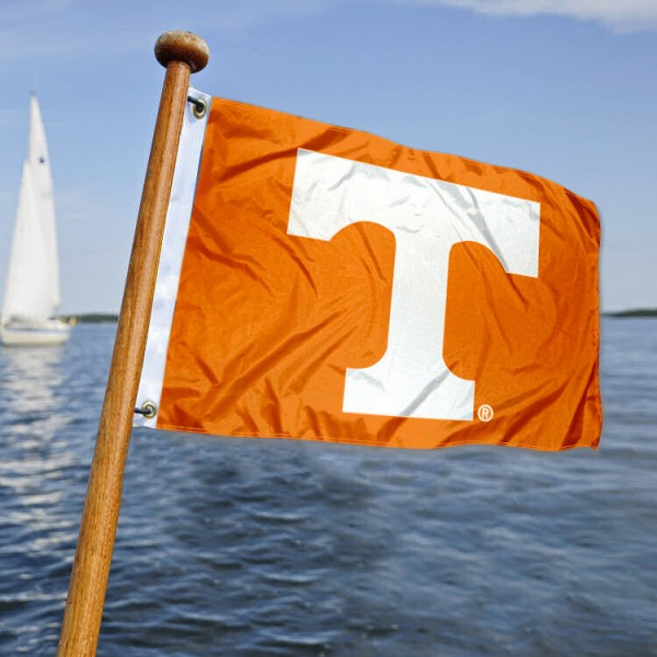 University of Tennessee Nautical Flag measures 12x18 inches, is made of two-ply polyesters, offers quadruple stitched flyends for durability, has two metal grommets, and is viewable from both sides. Our University of Tennessee Nautical Flag is officially licensed by the selected university and the NCAA and can be used as a motorcycle flag, golf cart flag, or ATV flag