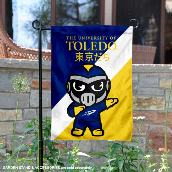 University of Toledo Tokyodachi Mascot Yard Flag is 13x18 inches in size, is made of double layer polyester, screen printed university athletic logos and lettering, and is readable and viewable correctly on both sides. Available same day shipping, our University of Toledo Tokyodachi Mascot Yard Flag is officially licensed and approved by the university and the NCAA.