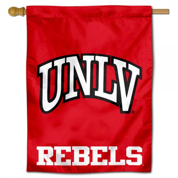 """UNLV Runnin Rebels Logo Banner Flag is constructed of polyester material, is a vertical house flag, measures 30""""x40"""", offers screen printed athletic insignias, and has a top pole sleeve to hang vertically. Our UNLV Runnin Rebels Logo Banner Flag is Officially Licensed by UNLV Runnin Rebels and NCAA."""
