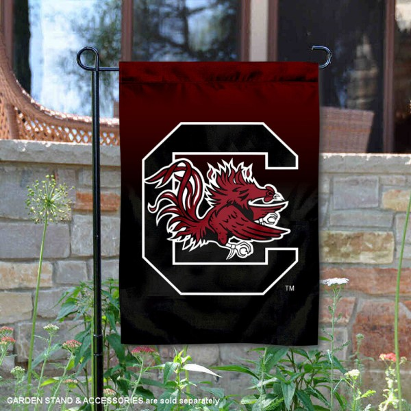 USC Gamecocks Gradient Ombre Logo Garden Flag is 13x18 inches in size, is made of thick blockout polyester, screen printed university athletic logos and lettering, and is readable and viewable correctly on both sides. Available same day shipping, our USC Gamecocks Gradient Ombre Logo Garden Flag is officially licensed and approved by the university and the NCAA.