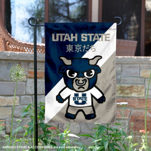 Utah State University Tokyodachi Mascot Yard Flag is 13x18 inches in size, is made of double layer polyester, screen printed university athletic logos and lettering, and is readable and viewable correctly on both sides. Available same day shipping, our Utah State University Tokyodachi Mascot Yard Flag is officially licensed and approved by the university and the NCAA.