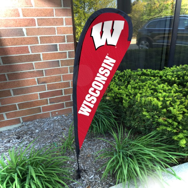 Wisconsin Badgers Small Feather Flag measures a 4' tall when fully assembled and roughly 1' wide. The kit includes a Feather Flag, 2 Piece Fiberglass Pole, pole connector, and matching Ground Stake. Our Wisconsin Badgers Small Feather Flag easily assembles and is NCAA Officially Licensed by the selected school or university.